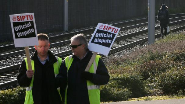 Luas drivers man a picket line in Sandyford, Dublin, in February
