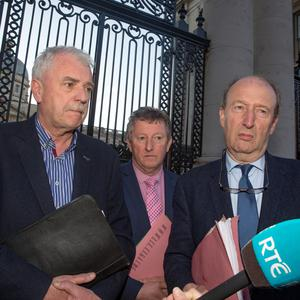 Independent Alliance TDs Finian McGrath, Kevin Moran and Shane Ross leave Government Buildings after talks on forming a new government