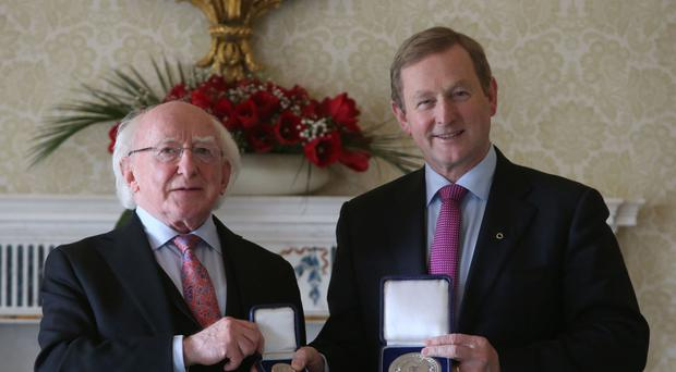 Newly elected Taoiseach Enda Kenny receives the Seal of the Taoiseach and Seal of Government from President Michael D Higgins at Aras an Uachtarain, Dublin