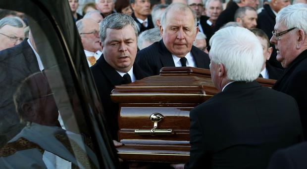 The coffin of Ryder Cup winning golfer Christy O'Connor Snr as it is taken from Galway Cathedral following his funeral