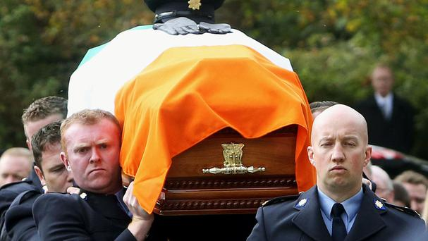 Garda Tony Golden, who was shot last year, has now been honoured with a medal