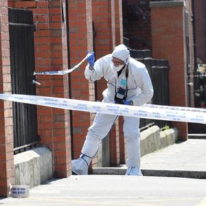 Forensic experts at the scene of a shooting in Dublin