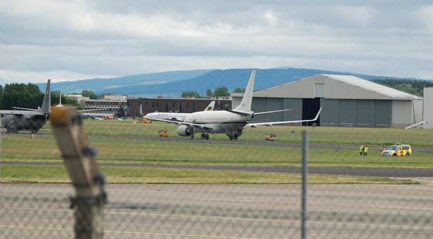 The pair were detained after accessing the runway through a perimeter fence
