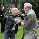 A protester is tackled by the Canadian Ambassador to Ireland, Kevin Vickers, at the state event