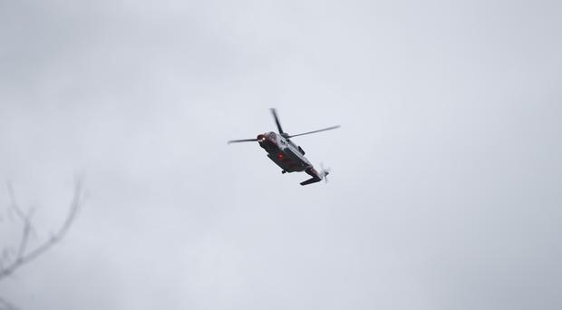 A Coast Guard helicopter joined the operation