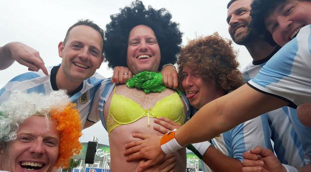 Richard Deegan, 37, (centre) from Dublin with his friends in the fan zone in Bordeaux, France