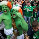 Fans celebrate in the fanzone at Smithfield Square in Dublin city centre.