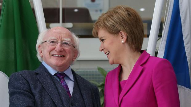 President Michael D Higgins greets Scotland's First Minister Nicola Sturgeon in Glasgow