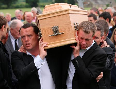 Mourners carry McNamara's coffin in Manister yesterday