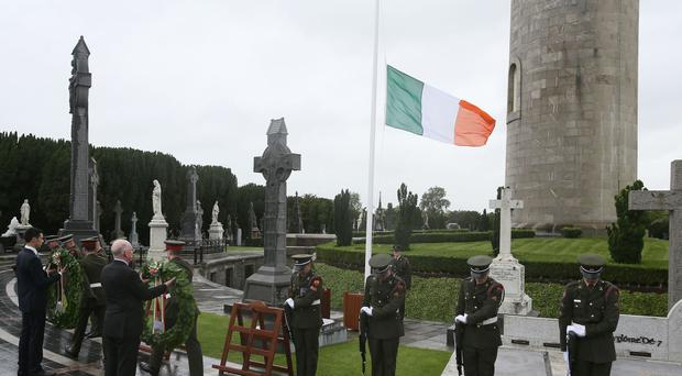 Charlie Flanagan, Minister for Foreign Affairs and Trade prepares to lay a wreath during a ceremony at Glasnevin cemetery in Dublin, to commemorate the centenary of the execution of Roger Casement