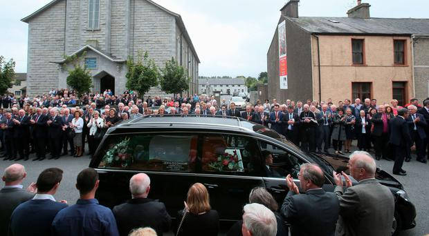 Mourners applaud as the coffin of Anglo Irish Agreement deal-maker and former tanaiste Peter Barry is carried from St Michael's Church, Blackrock, Cork