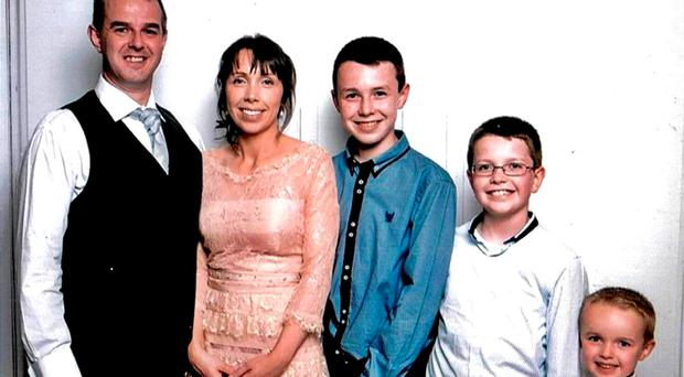 Alan Hawe with his wife, Clodagh, and their children Liam (13), Niall (11) and six-year-old Ryan. Photo: Hawes/Coll families/PA Wire