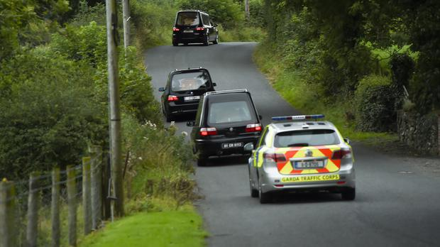 Hearses leaves the scene at Oakdene, Barconey, Ballyjamesduff in Cavan, where a family of five were found dead in their countryside home
