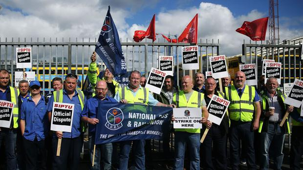 Dublin Bus workers outside Ringsend Bus depot in Dublin