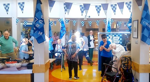 A patient and staff dancing to the Macarena in the canteen at Our Lady's Hospice in Harold's Cross in Dublin