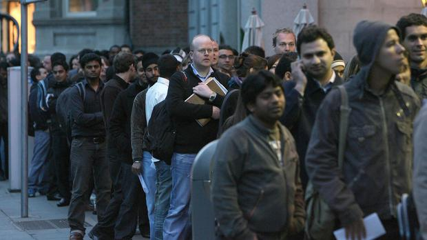 Hundreds of people queue for jobs at a supermarket in Dublin.