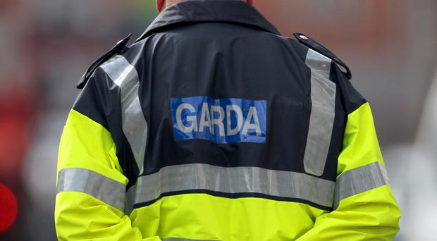 Gardai said a wounded man was discovered on the road close to the flat