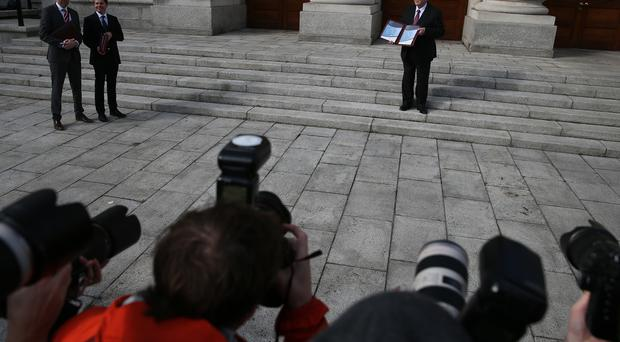Finance Minister Michael Noonan outside Government buildings in Dublin before he delivered the Budget.