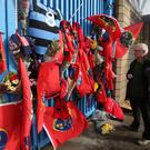 Munster Rugby fans Dermot Kelly and Tom Galvin (right) pay tribute to former Ireland and Munster star Anthony Foley outside Thomond Park