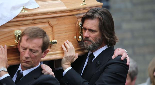 Jim Carrey carries the coffin of ex-girlfriend Cathriona White in Cappawhite, Co Tipperary