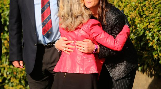 Anthony Foley's sister-in-law Rosie Foley and father Brendan are consoled as the coffin of Munster Rugby head coach Anthony Foley is brought to repose in St. Flannan's Church, Killaloe in Co Clare, ahead off his funeral tomorrow. PRESS ASSOCIATION Photo. Picture date: Thursday October 20, 2016. See PA story DEATH Foley. Photo credit should read: Niall Carson/PA Wire