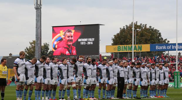 A minute's silence is observed in memory of Anthony Foley at Thomond Park