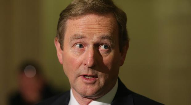 Enda Kenny vowed to work with the new administration in Washington