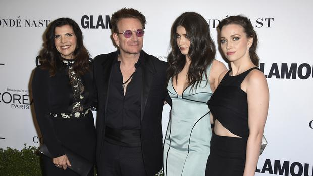 Ali Hewson and Bono with their daughters Eve Hewson and Jordan Hewson at the Glamour Women of the Year Awards in Hollywood (AP)