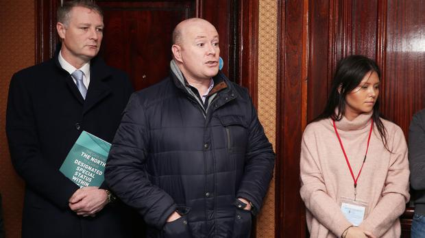Austin Stack, centre, son of murdered Brian Stack, speaks at a press conference where he confronted Sinn Fein leader Gerry Adams