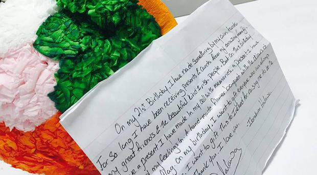 A paper bouquet in the colours of the Irish flag and a letter that Ibrahim Halawa handed to his mother (handout/PA Wire)