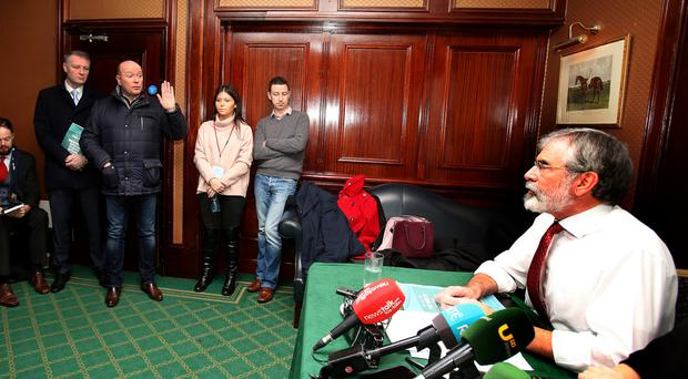 Austin Stack, son of Brian Stack, confronts Gerry Adams at a Dublin hotel last month
