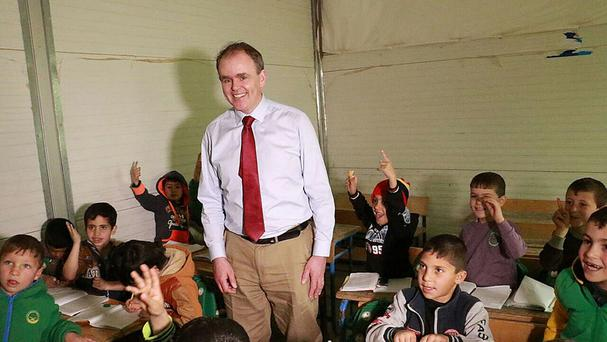 Joe McHugh meets Syrian children at a school in the Za'atari refugee camp