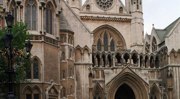 Estranged pair are in the High Court, London