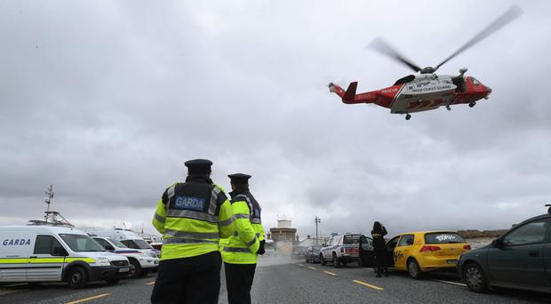 A Coast Guard helicopter arrives in Blacksod to refuel earlier this week (PA)