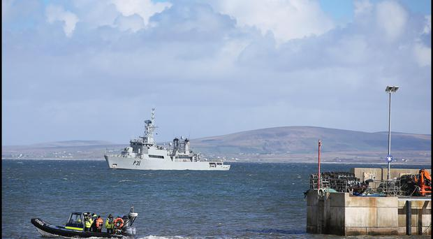 A Garda boat passes LE Eithne at Blacksod, Co Mayo, during the mission to recover the Rescue 116 crew
