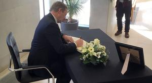 Enda Kenny signing a Book of Condolence for the victims of the Westminster terror attack at the British Embassy in Dublin (Irish government/PA)