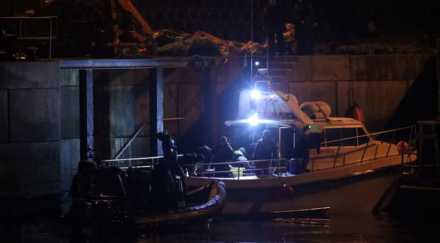 Members of the search and rescue team return to the quayside at Blacksod