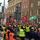 Hundreds of striking Bus Eireann workers and colleagues protest outside Leinster House in Dublin