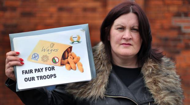 Emma Magee protests about soldiers' pay and conditions