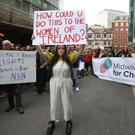 People outside the Department of Health in Dublin protest over plans to grant ownership of the new National Maternity Hospital to the Sisters of Charity religious order