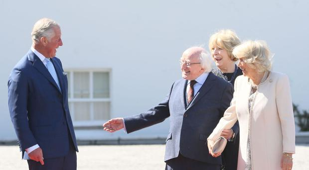 The Prince of Wales and Duchess of Cornwall are welcomed by Irish President Michael D Higgins and wife Sabina Coyne.