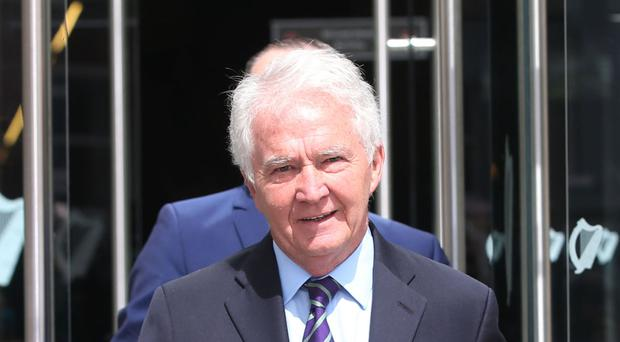 Former Anglo Irish Bank chairman Sean Fitzpatrick leaving Dublin Criminal Court