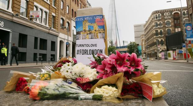 Floral tributes are laid near Borough Market in London
