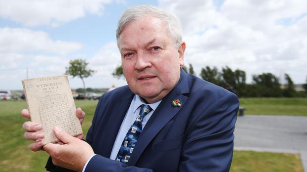 Brian Hanratty holds a field map belonging to his father Alfie Hanratty following a ceremony at the Island of Ireland Peace Park in Messines, Belgium to commemorate Battle of Messines Ridge.