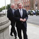 Outgoing Taoiseach Enda Kenny arrives at Government Buildings, Dublin