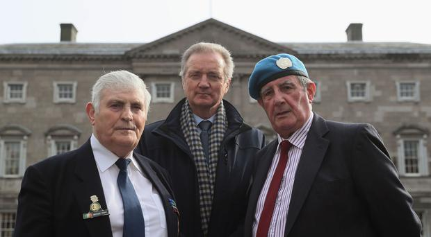 UN Veterans Quartermaster Sergeant Michael Tighe, left, Corporal Tadgh Quinn, right, and Retired Commandant Leo Quinlan, son of late Commandant Pat Quinlan, outside Leinster House