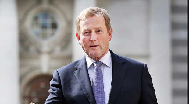 Enda Kenny leaves the Department of the Taoiseach for the last time yesterday