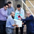 Khalid Omran (right), the father of three-year-old Omar Omran, who was stabbed to death in Kimmage, carries his son's remains from the mosque in Clonskeagh for burial in Newcastle, Co Dublin