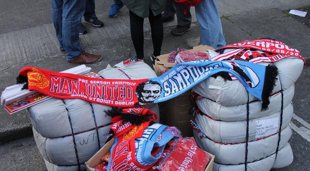 Counterfeit goods seized during Manchester United's friendly fixture in Dublin last week ( An Garda Sochna/PA)