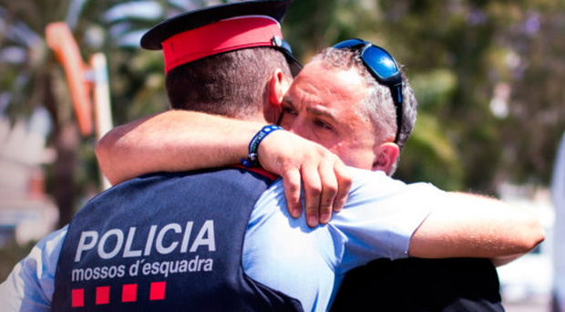 Emotional scenes on the streets of Barcelona yesterday as tributes were paid to the victims